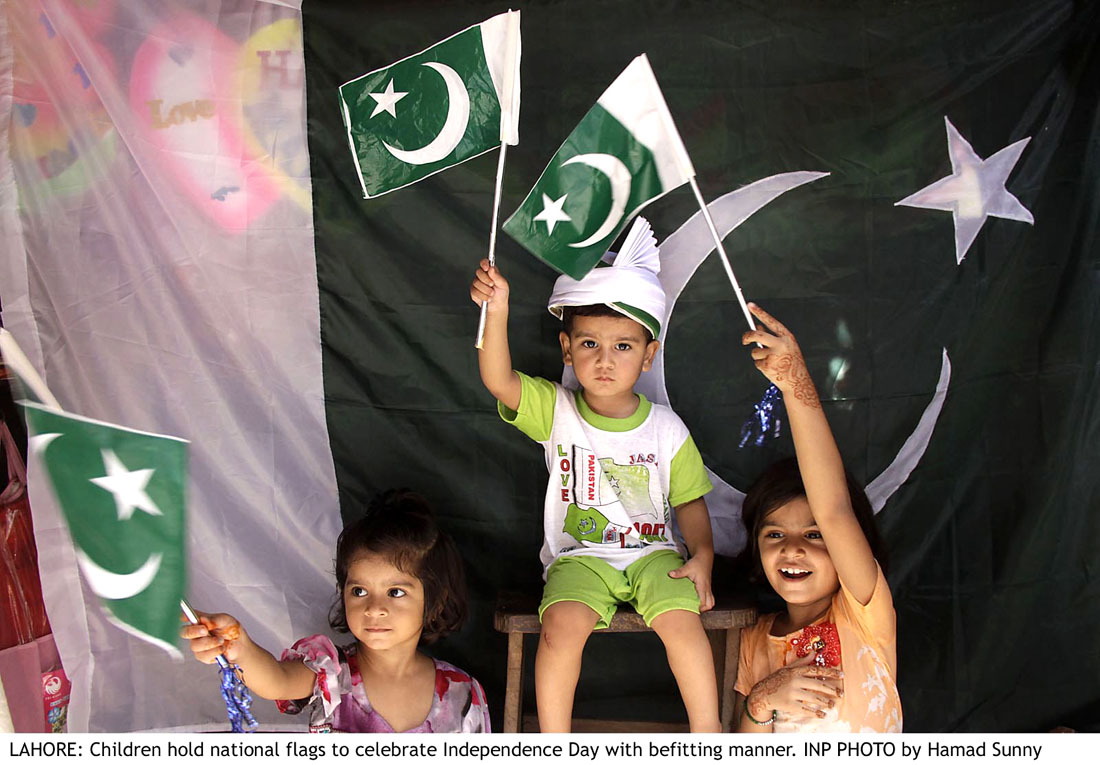 Children hold National Flag to Celebrate 14 August 2013