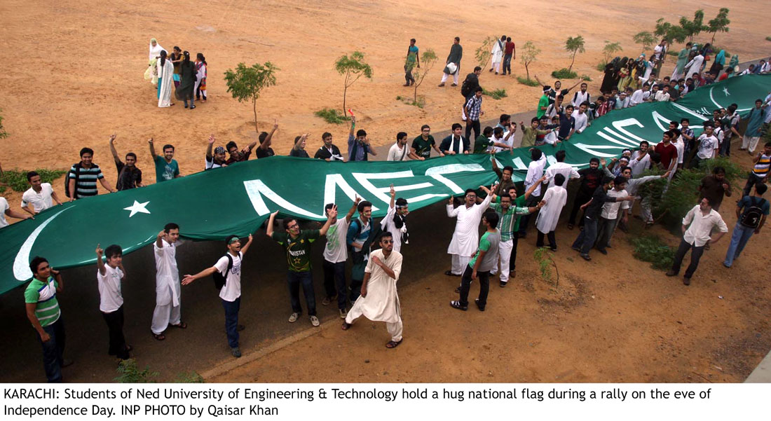 Students of NED UET Karachi hold Flag