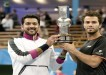Pakistan's Aisam-Ul-Haq Qureshi (L) and Netherlands' Jean-Julien Rojer pose with the trophy of the ATP Stockholm Open tournament in Sweden, October 20, 2013. PHOTO: AFP