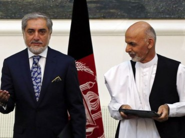 Historic, anxious handover as Afghanistan swears in new leader