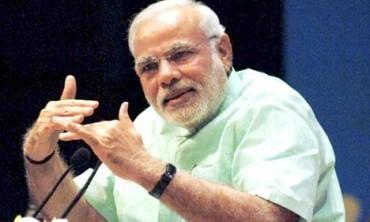 Modi, in rock star US debut, vows to make India proud